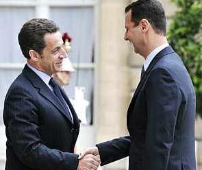 Nicolas Sarkozy y  Bashar al-Asad.