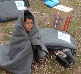 Un niño siriro en un campamento de ACNUR
