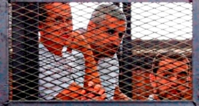 Peter Greste, Mohamed Fahmy y Baher Mohamed , periodistas encarcelados por el gobierno de Egipyo: Foto The Guardian