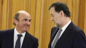 En el Gobierno atribuyen a Luis de Guindos la fallida amnistía fiscal de 2012, aunque la firmó Montoro