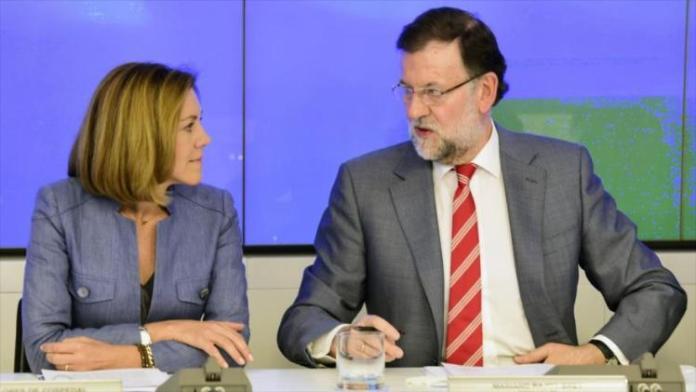 La secretaria general del Partido Popular (PP), María Dolores de Cospedal, junto a su presidente y presidente en funciones del Gobierno español, Mariano Rajoy, 25 de mayo de 2015.