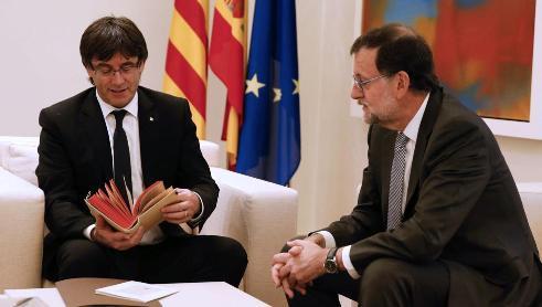 Carles Puigdemont y Mariano Rajoy.